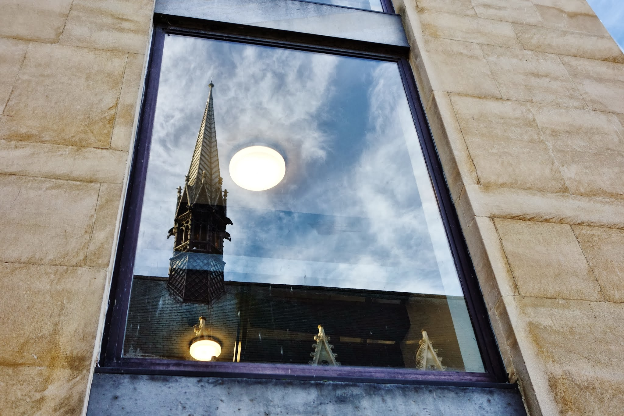 Reflection of chapel spire in staircase 12 window